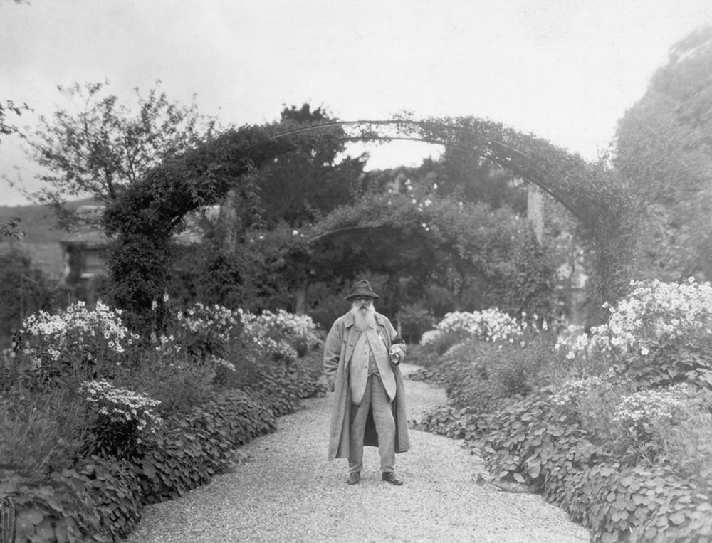 Claude Monet in his garden at Giverny